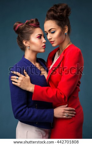 Fashion portrait of two girls with bright makeup