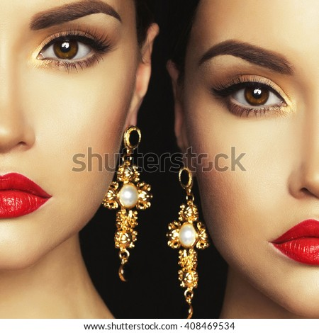 Fashion portrait of two young beautiful lady with earrings on black background - stock photo