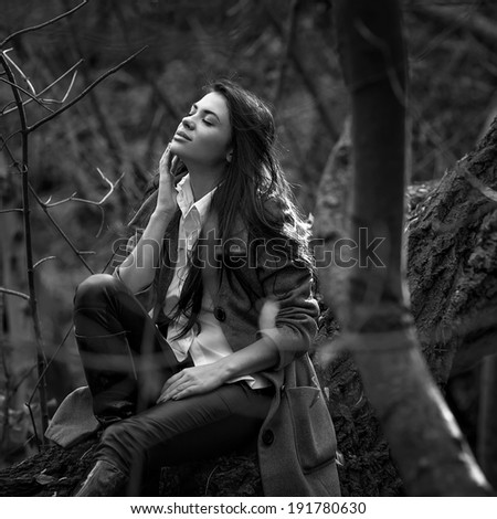 Fashion portrait of woman in mystery forest, black and white