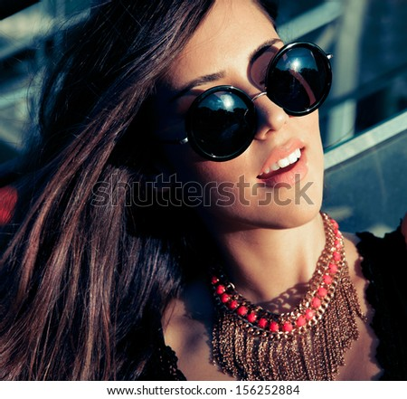 Fashion portrait of woman in sunglasses. outdoors shot. - stock photo