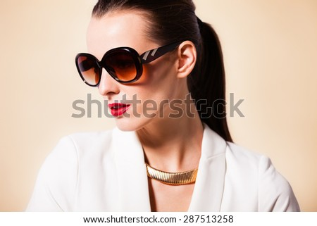 Fashion portrait of woman with sunglasses.