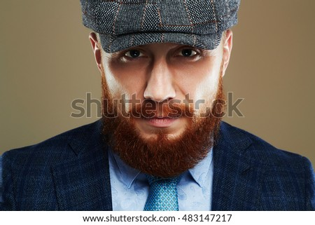 fashion Portrait of young bearded man.Hipster boy.handsome man in hat.Brutal man with red beard