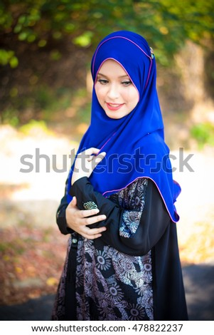 Fashion portrait of young beautiful asian muslim woman with wearing hijab. Selective focus. Toned image.
