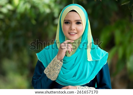 Fashion portrait of young beautiful muslim woman wearing hijab - stock photo