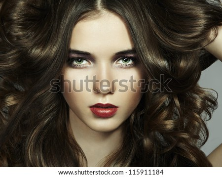 Fashion portrait of young beautiful woman. Close-up - stock photo