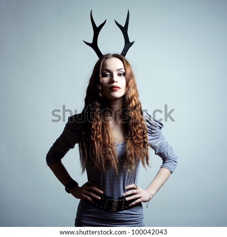 Fashion portrait of young beautiful woman with horn