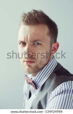 Fashion portrait of young gentleman in bowtie - stock photo