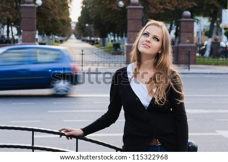 Fashion portrait of young gorgeous blond in city - stock photo