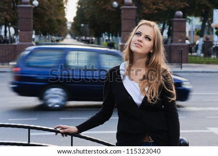 Fashion portrait of young gorgeous blond in city