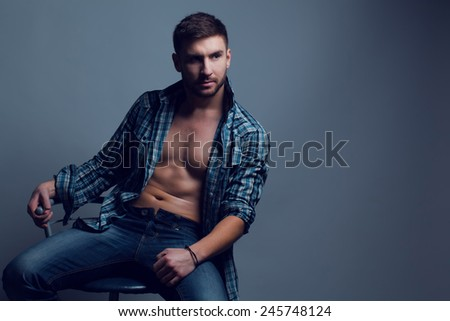 Fashion portrait of young man in casual wear. - stock photo