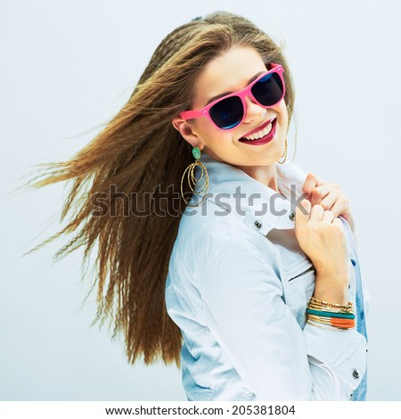 Fashion portrait of young model . Sunglasses pink. White background. - stock photo