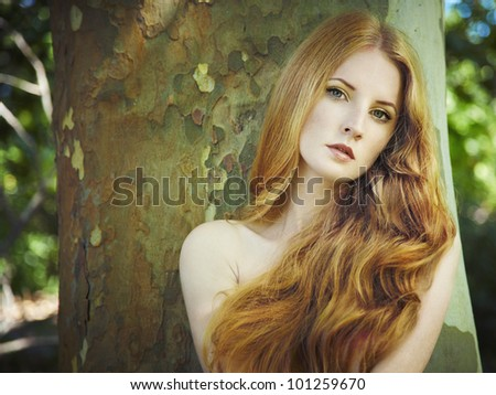 Fashion portrait of young naked woman in garden. Beauty summertime - stock photo