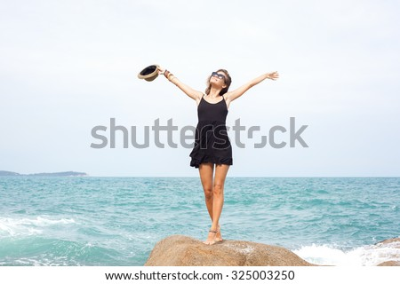 fashion portrait of Young pretty female model on the sea. Outdoors lifestyle portrait - stock photo