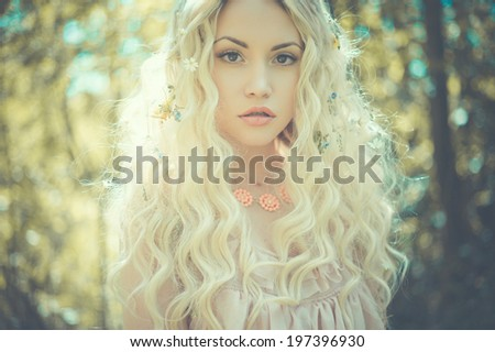 Fashion portrait of young pretty woman in summer sunny day - stock photo