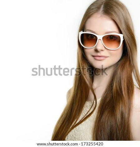 Fashion portrait of young pretty woman wearing sunglasses over white - stock photo