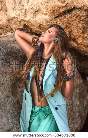 Fashion portrait of young  sexy beautiful girl, model, woman in blue stylish clothes, bright accessories, near mountain in summer, boho style vacation photography - stock photo