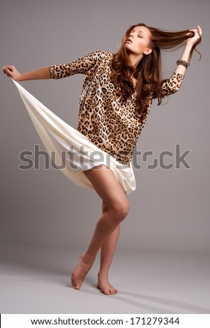 Fashion portrait of young woman - stock photo
