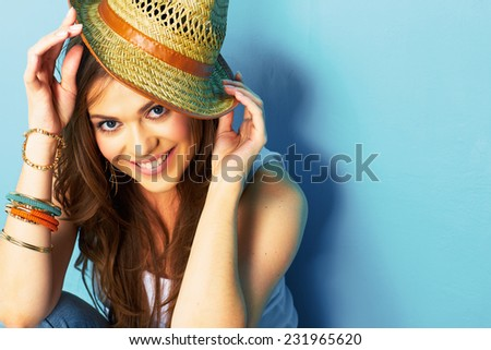 fashion portrait of young woman hand touching her straw hat . close up face . - stock photo