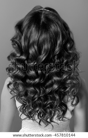 Fashion portrait of young woman with magnificent curly hair. Perfect make-up. Bride .Wedding style.