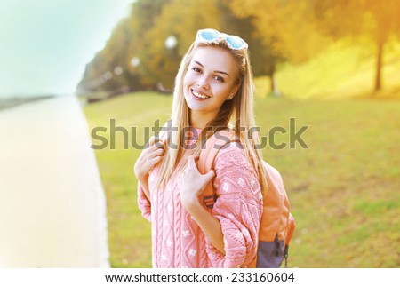 Fashion portrait pretty hipster smiling girl having fun outdoors - stock photo