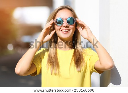 Fashion portrait pretty smiling girl in sunglasses enjoying outdoors in summer - stock photo