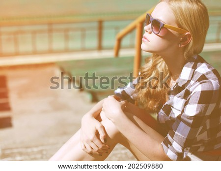 Fashion portrait pretty woman in sunglasses looking away, street fashion, copy space - stock photo