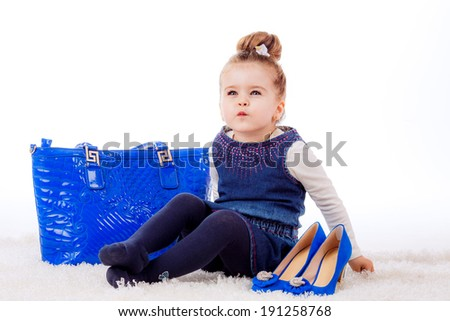 fashion portrait. Stylish little girl with shoes and bag mom. fashionista, shopping
