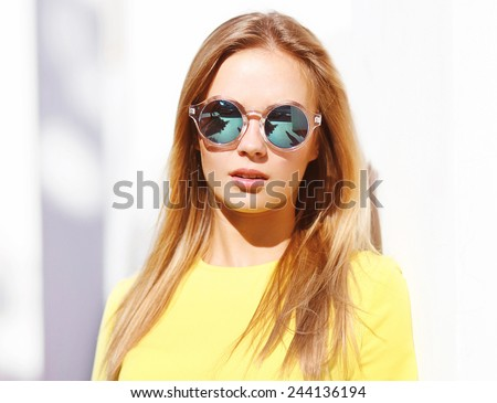 Fashion portrait stylish pretty woman in sunglasses posing  in the city, street fashion - stock photo
