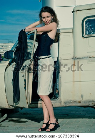 Fashion pretty woman near old car - stock photo