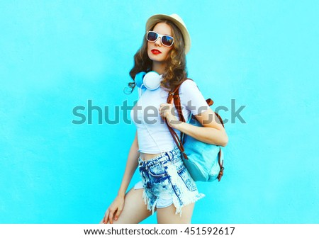 Fashion pretty woman posing over colorful blue background