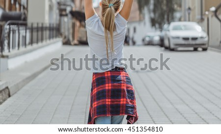 Fashion pretty woman wearing in checkered shirt in the city