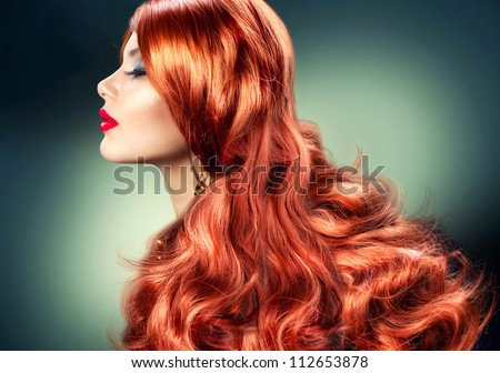 Fashion Red Haired Girl Portrait. Healthy Long Red Hair - stock photo