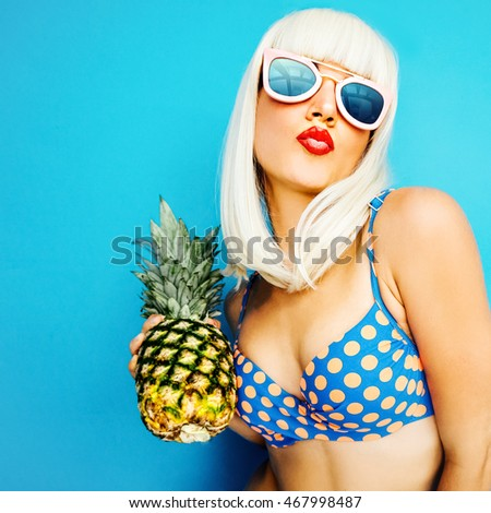 Fashion Retro Blonde on a blue background with Pineapple. Beach Party