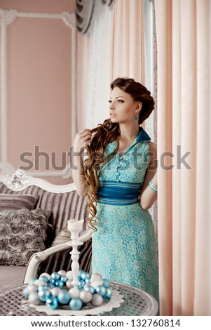 Fashion rich woman in luxury interior - stock photo