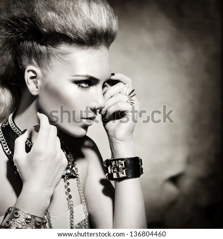 Fashion Rocker Style Model Girl Portrait. Hairstyle. Rocker or Punk Woman Makeup and Hairdo. Black and White Portrait of Glamour and Stylish Young Woman - stock photo