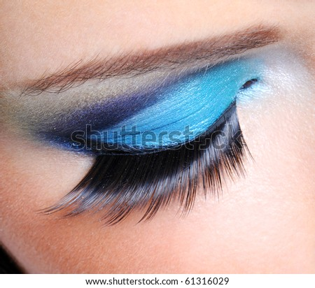 Fashion saturated make-up with long false eyelashes
