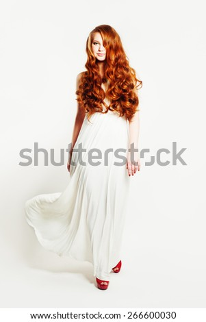 Fashion sexy woman with long red curly hair - stock photo