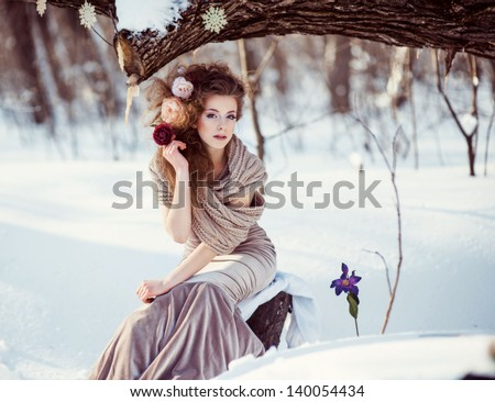Fashion shoot of young beautiful girl in the winter forest - stock photo