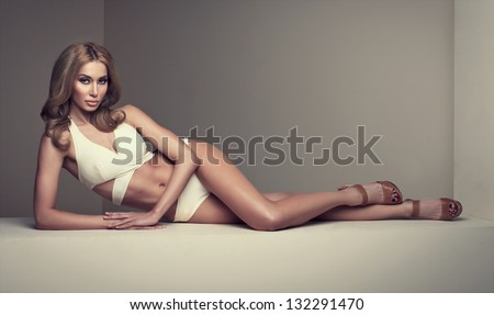 Fashion shoot of young sexy woman - stock photo