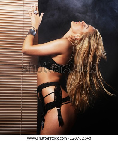 Fashion shoot of young sexy woman in black  lingerie - stock photo