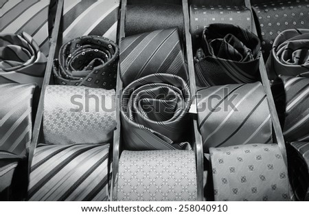 Fashion shop choice elegant dressing accessories. Neck ties at a store in Italy. Black and white tone. - stock photo