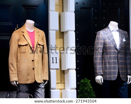 Fashion shop display window with mannequins   - stock photo
