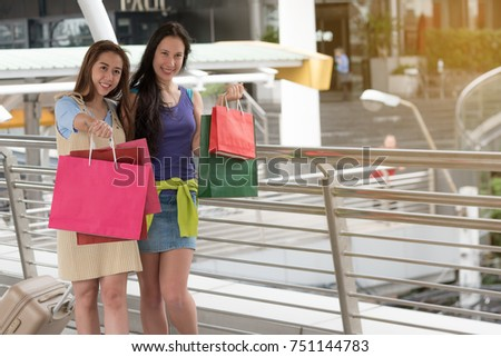 fashion shopping concept : beautiful teenager women smile walking after purchase mall ,selective focus