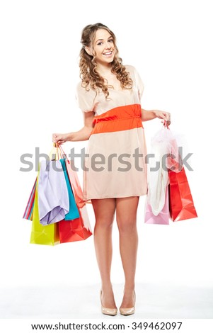 Fashion Shopping Girl full length Portrait. Beauty Woman with Shopping Bags isolated on White. Shopper. Sales