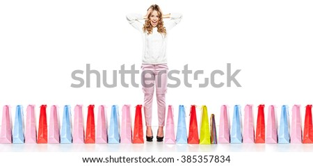 Fashion Shopping Girl full length Portrait. Beauty Woman with Shopping Bags isolated on White. Shopper. Sales - stock photo