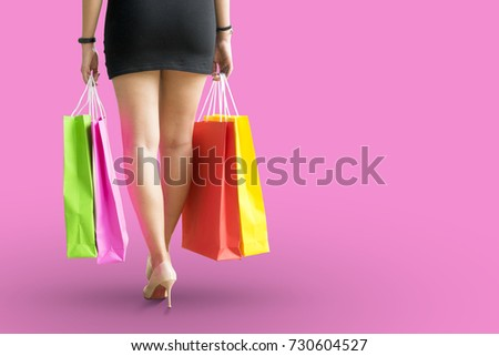 Fashion Shopping Girl Portrait. Beauty pink background.