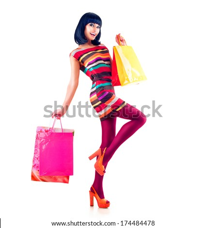Fashion Shopping Model Girl full length Portrait. Beauty Woman with Shopping Bags isolated on White. Shopper. Sales  - stock photo