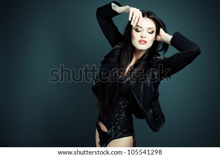 Fashion shot beautiful sexy girl in lingerie and leather jacket on top - stock photo