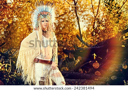 Fashion shot of a beautiful girl in style of the American Indians. Western style. Jeans fashion. - stock photo