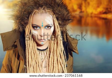 Fashion shot of a beautiful girl outdoor. Autumn. - stock photo